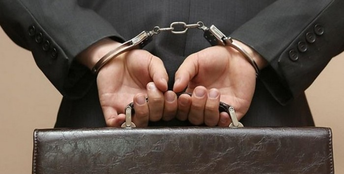 Предприниматель в наручниках